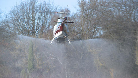 helicopter sprays and turns Stock Video Footage