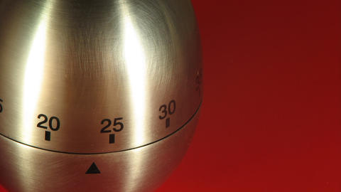Egg Kitchen Timer on a Red Table Stock Video Footage