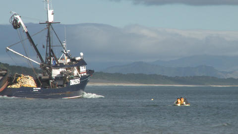 siene trawler and inflatable Stock Video Footage