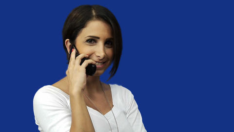 Young woman using mobile phone, blue screen background Footage