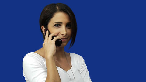 Young woman using mobile phone, blue screen background Stock Video Footage