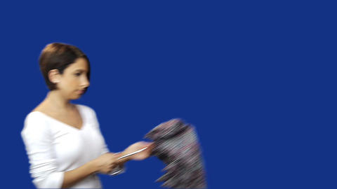 Young woman opening umbrella blue screen background Footage