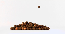 Peppercorns falling in super slow motion on a heap Footage