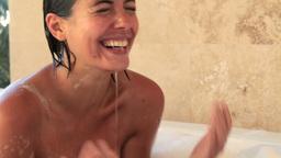 Woman splashing her face Footage