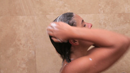 Woman washing her hair with shampoo Footage