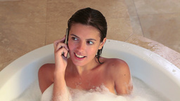Woman in a bath while calling Footage