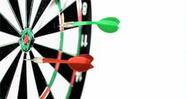 Three darts being thrown in super slow motion on a Footage
