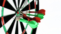 Darts grouped together in super slow motion being  Footage