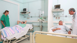 Nurse and doctor talking in the room of patients Footage