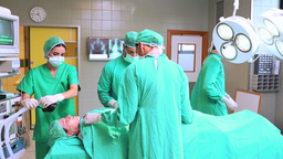 Surgical team preparing the patient to be operated Footage
