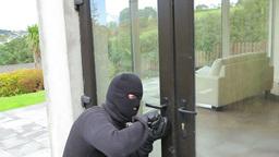 Burglar opening lock on door Footage