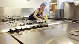 Woman Cleaning A Counter Of A Kitchen stock footage