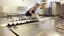 Cleaning Woman In A Kitchen Of A Restaurant stock footage