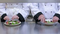 Two cooks preparing salads Footage