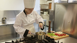 Cook Preparing A Soup In A Kitchen stock footage