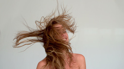 Woman shaking her hair after a shower Footage