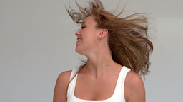 Woman tossing her hair Footage
