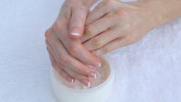Woman moisturising hands Live Action