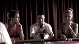 Man sitting winning at poker Footage