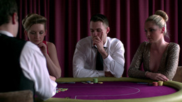 Dealer dealing cards at the poker table Footage
