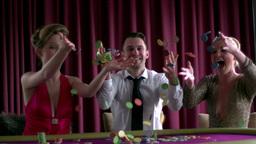 Joyful people throwing chips in the air Footage