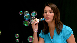 Woman blowing bubbles Footage