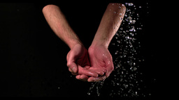 Cupped hands under running water Footage