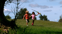 Two children running with kite Footage