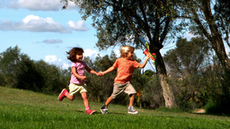 Two children playing with kite Footage