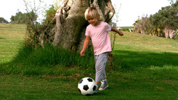 Child dribbling with the football Footage