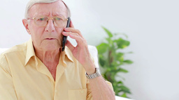 Senior calling with mobile phone Footage