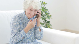 Old woman calling with mobile phone Footage