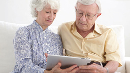 Old couple using a tablet Footage
