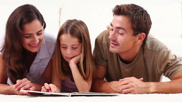 Family reading a book Footage