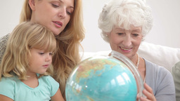 Family looking at a globe Footage