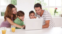 Family using a white laptop Footage