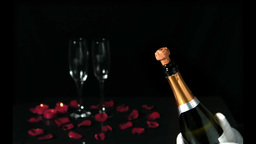 Champagne cork popping in front of two flutes Footage