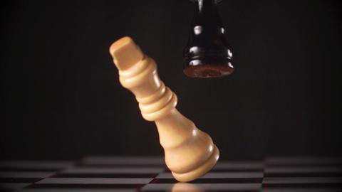 Black king knocking over white king Live Action