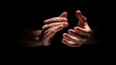 Hands clapping on black background close up Footage