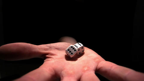 Hands grasping white dice Footage