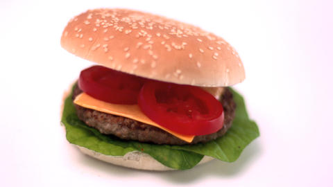 Bun Falling Onto Cheese Burger On White Background stock footage