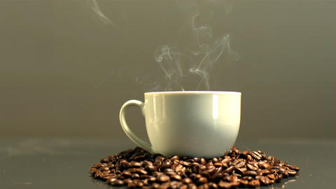 Steam rising from cup of coffee Footage