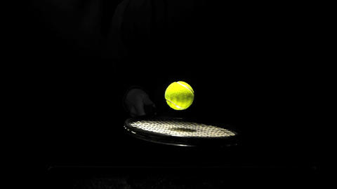 Tennis ball bouncing on a racket Live Action
