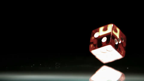 Red dice falling and bouncing close up Live Action