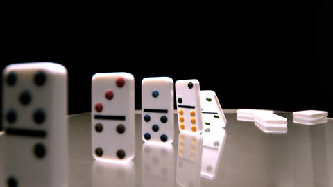Dominoes toppling over in sequence Live Action