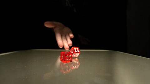 Hand throwing two red dice Footage