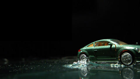 Toy car rolling over water Footage