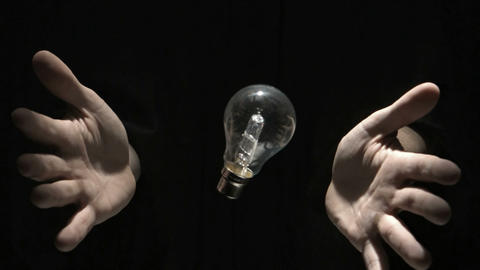 Mans hands throwing bulb Live Action