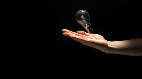 Mans hand throwing bulb Live Action