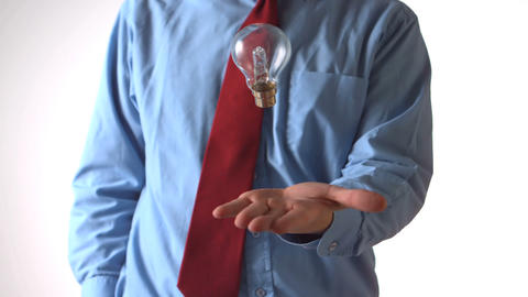 Man in shirt and tie throwing a light bulb Footage